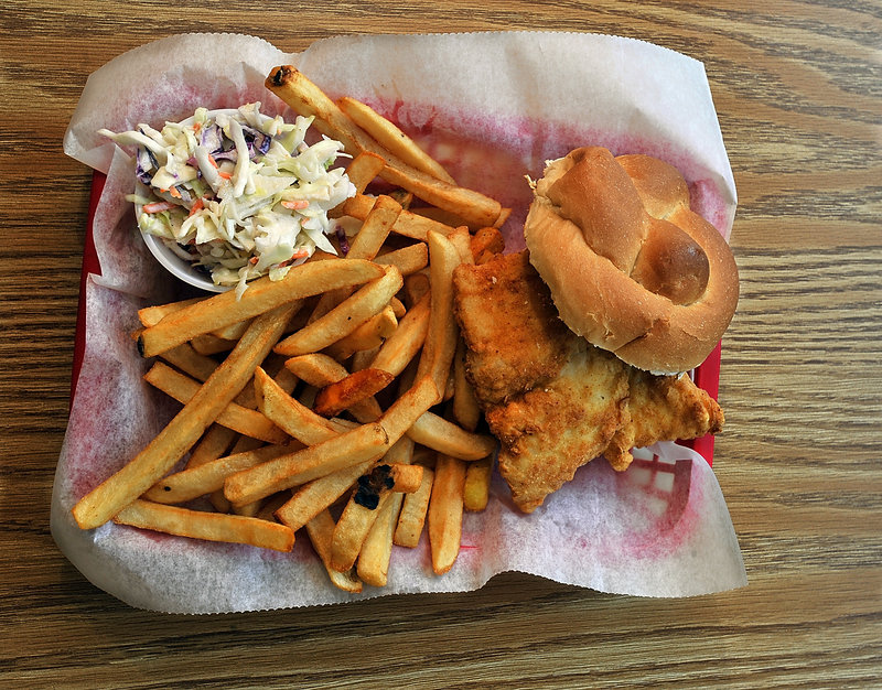 At Charlie's Diner, the fried haddock sandwich is served with fries and slaw. And breakfast is served all day.