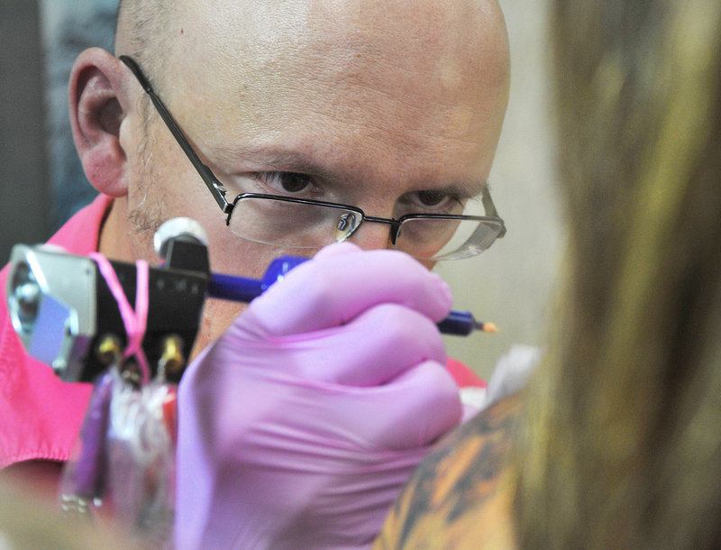 """Chris Dingwell at work at his Chris Dingwell Studio says, we're breaking away from the biker aesthetic. We're college-educated folks with an art background. You are commissioning an artist."""""""