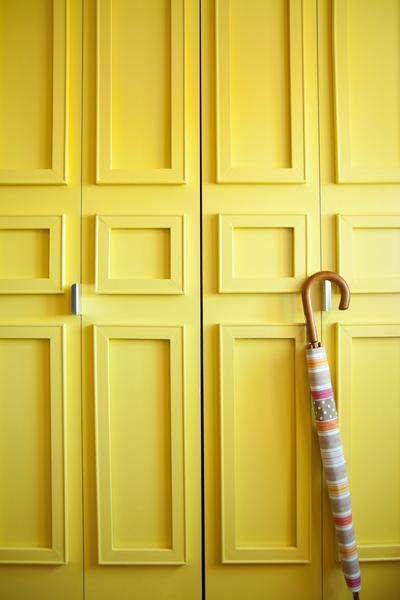 Doors are customized with moldings created by sticking on pieces of wood using Command picture hanging stripsfrom 3M.