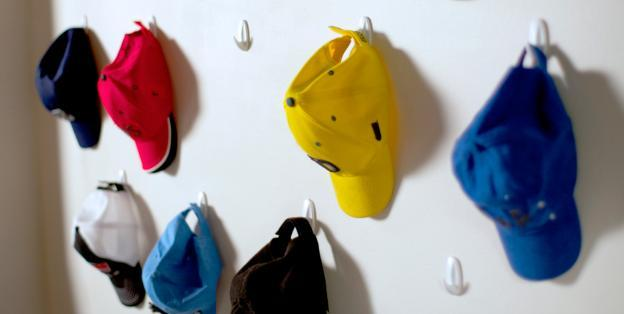 Adhesive hooks from 3M are a safe alternative to nailing into walls of dorm rooms or apartments.