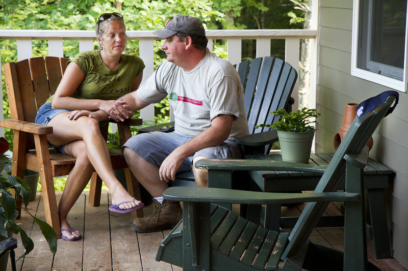 Michelle Melanson and Tracy Charpentier, close friends of lost fisherman Billy McIntire, sit on the porch of their Ogunquit home late last month. According to Melanson, the empty chair in the foreground is where McIntire used to sit during his frequent visits.