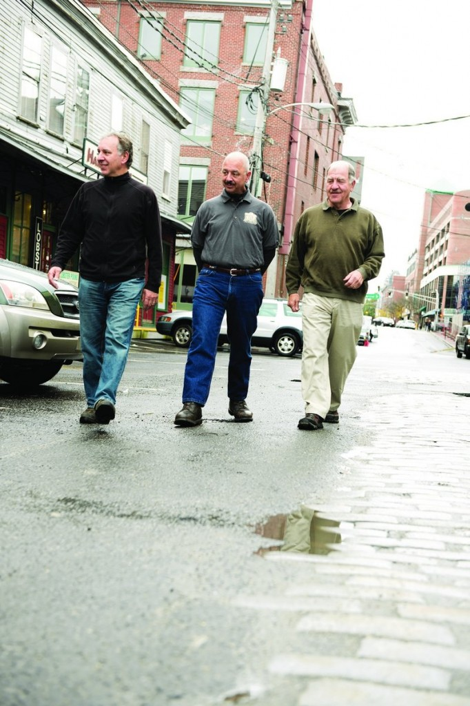 The brothers Alfiero - Mike, Ben and Nick - stroll the waterfront.