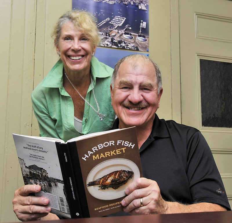 Kathleen and Nick Alfiero with the family's first cookbook.
