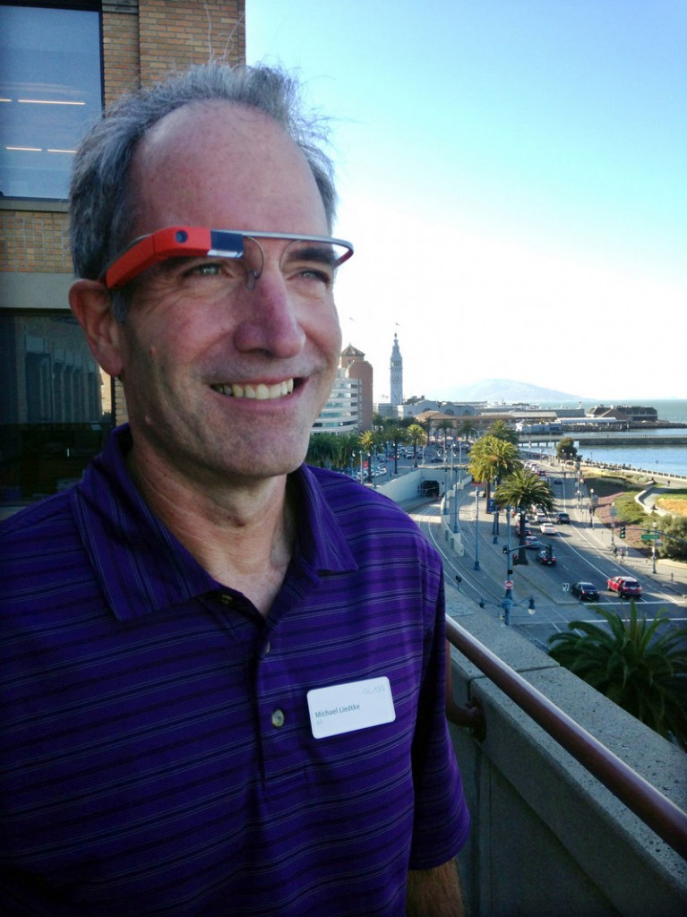 Reporter Michael Liedtke models Google Glass at a Google base camp in San Francisco.