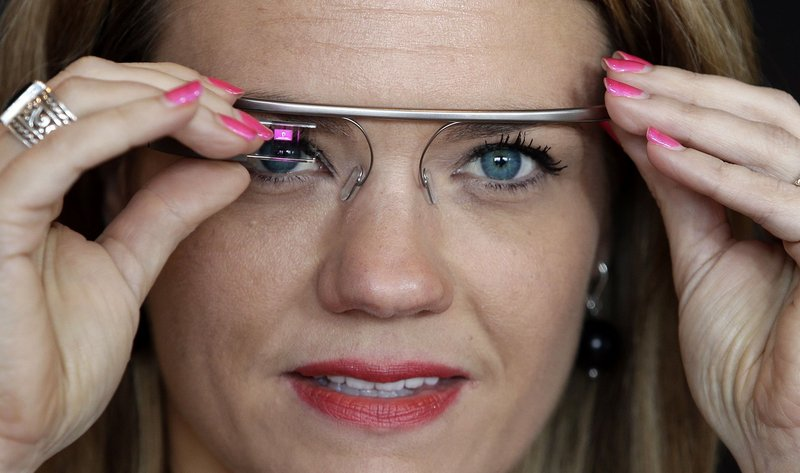 "Sarah Hill, a Google Glass contest winner, tries out the device. ""This is like having the Internet in your eye socket,"" Hill said. ""But it's less intrusive than I thought it would be. I can totally see how this would still let you still be in the moment with the people around you."""