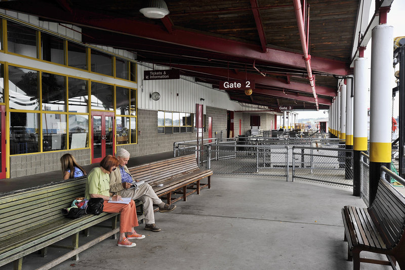 "Travelers sit in the outside waiting area of the Casco Bay Ferry Terminal in Portland on Saturday. A renovation and expansion project will make the terminal ""better, particularly for the customers,"" Operations Agent Larry Legere said."