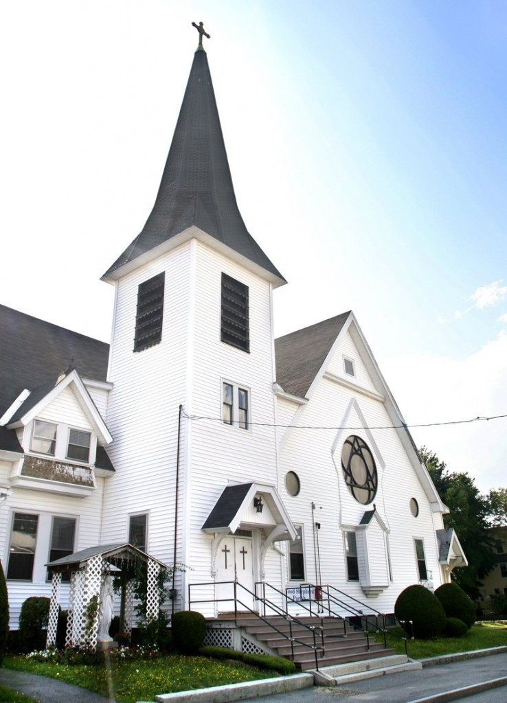 The former Notre Dame de Lourdes Church on Cutts Avenue in Saco would be bought by the city and demolished to create more parking spaces for downtown employees who often park in nearby residential areas.