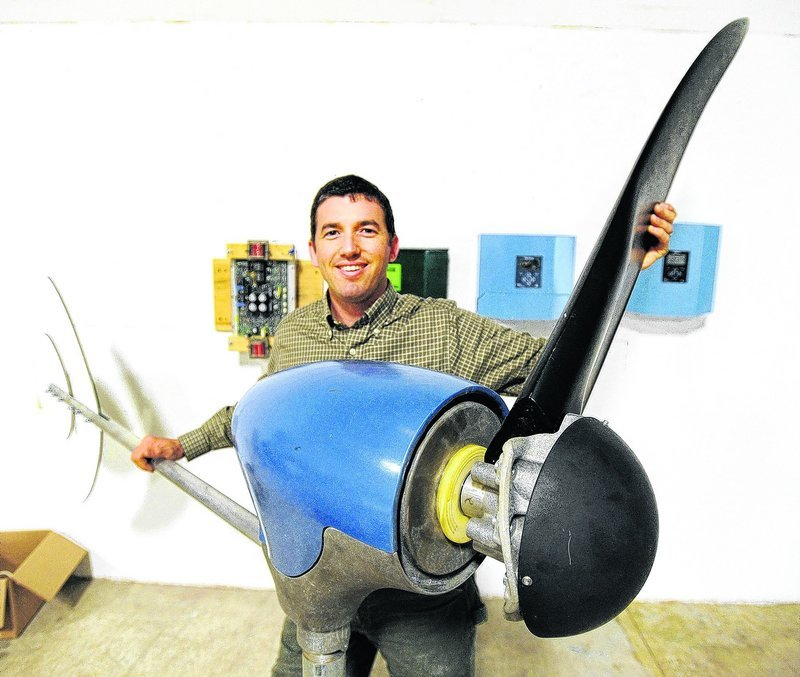 Ben Polito, president of Pika Energy in Westbrook, holds one of three blades on a personal-size wind turbine.