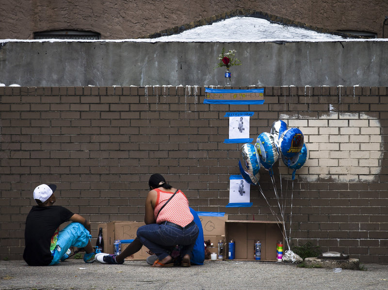 Mourners visit a memorial for Antiq Hennis in the Brownsville neighborhood of Brooklyn on Monday.