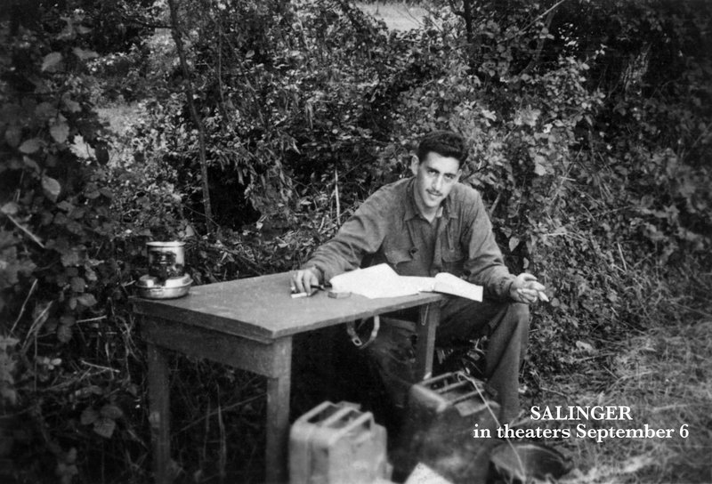 "J.D. Salinger smiles for a picture while he works on ""Catcher in the Rye"" during World War II."