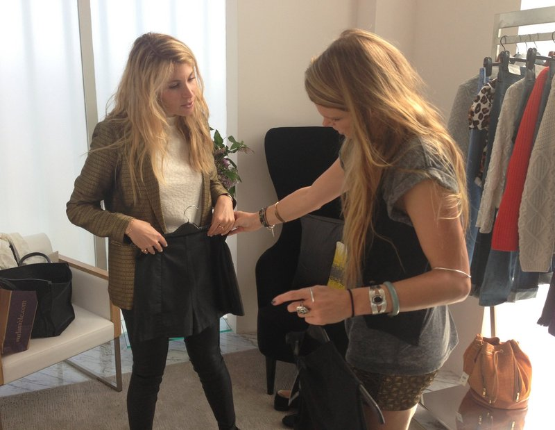Personal stylist Lexi Clayburn, right, helps client Karen Ashkenazi select items at Topshop in Los Angeles.