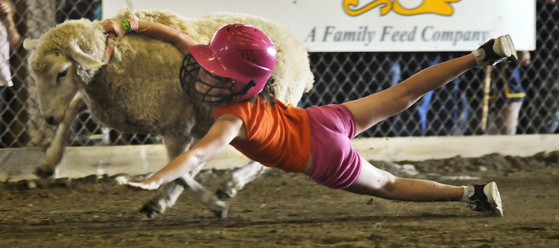 A sheep sheds its rider in a previous competition. This year's Litchfield Fair Mutton Bustin' contest takes place Sunday.