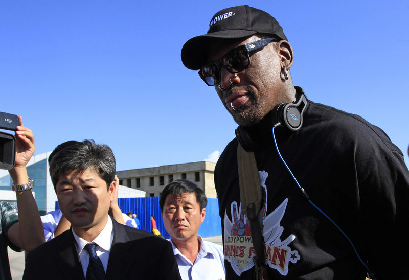 Dennis Rodman arrives at Pyongyang airport in North Korea on Tuesday. Rodman said he plans to hang out with authoritarian leader Kim Jong Un, have a good time and maybe bridge some cultural gaps – but not be a diplomat. He also hopes to start a basketball league there.
