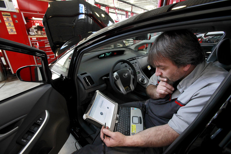 Diagnostic technician Kurt Juergens, of Foxborough, Mass., uses a laptop to diagnose the brake system on a 2010 Toyota Prius. A pair of hackers maneuvered their way into the computer systems of a 2010 Prius through a port used by mechanics.