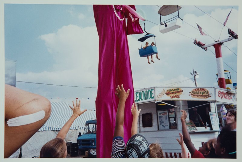 "From ""Mentor,"" ""Stilt Man, Ohio State Fair,"" 1985, by Renee Psiakis."