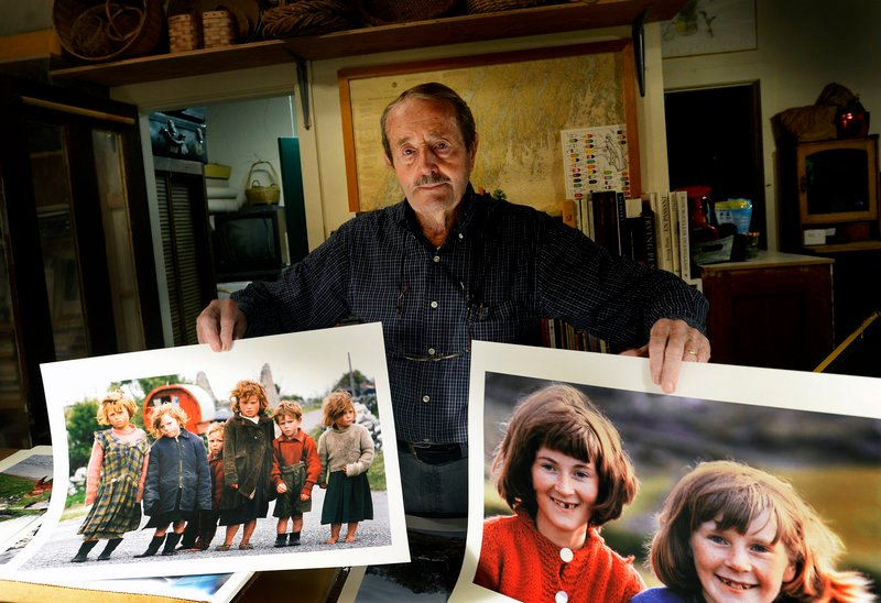 Robert Freson displays photographs of children that he took in Ireland in the 1960s.