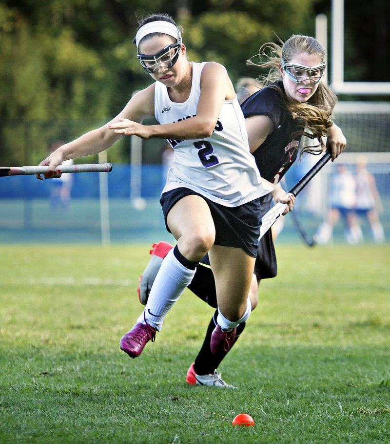 Abby Doyle of Marshwood races for the ball ahead of Maggie Carbin of Scarborough during Scarborough's 2-1 field hockey victory Wednesday.