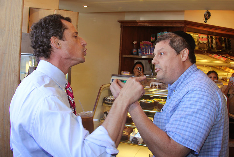 Anthony Weiner and a heckler don't shy from pointing fingers Wednesday in a Brooklyn bakery.