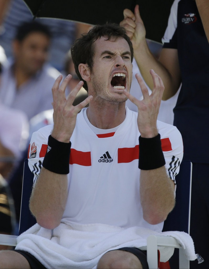 The gestures say it all – it's the agony of defeat for Britain's Andy Murray who, needless to say, is upset about being upset by Switzerland's Stanislas Wawrinka.