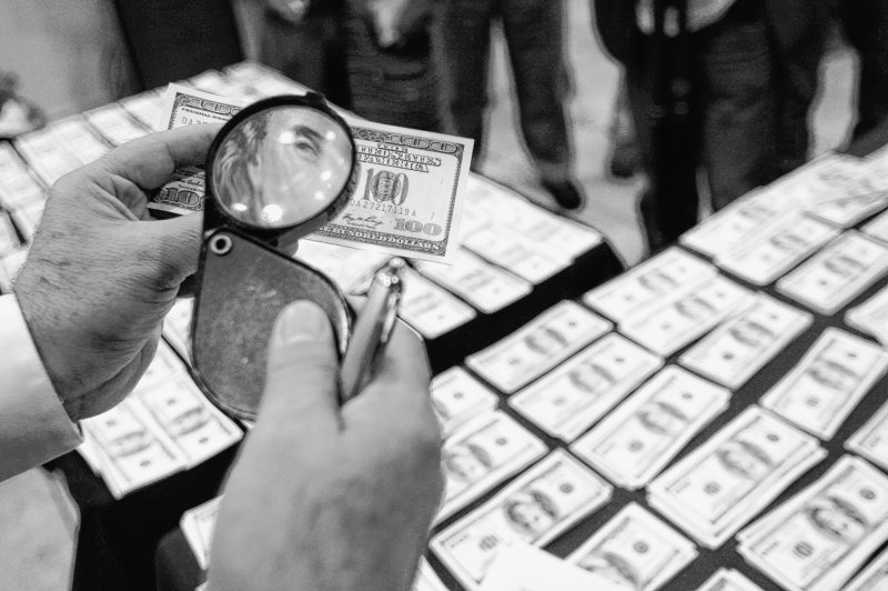 Counterfeiters earn up to $20,000 in real currency for every $100,000 in false bills they produce.