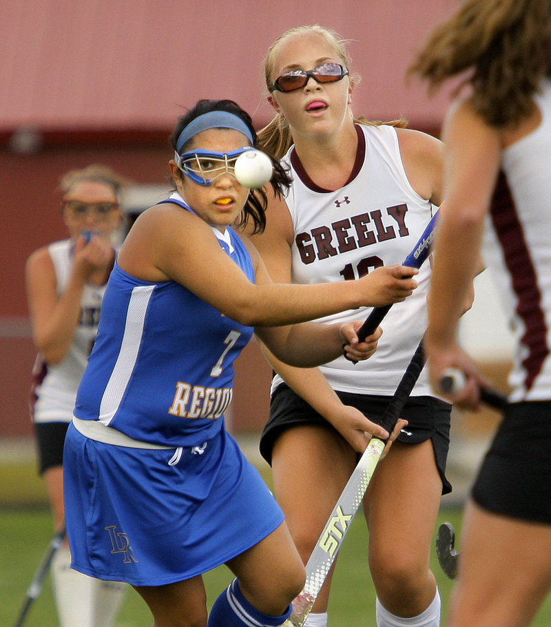 Bridgett Letarte of Lake Region, left, and Anna Murphy of Greely keep their eyes on the ball while contending for possession Thursday during Lake Region's 5-0 victory in field hockey.