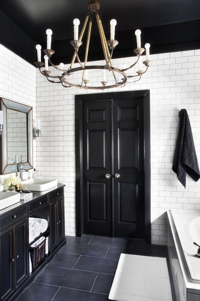 A chandelier brings a decorative and unexpected touch to a normally task-oriented space – the bathroom.