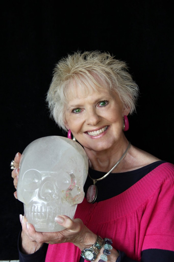 JoAnn Parks of Houston, Texas, brings her crystal skull, Max, to Leapin' Lizards' Portland and Freeport stores this weekend.
