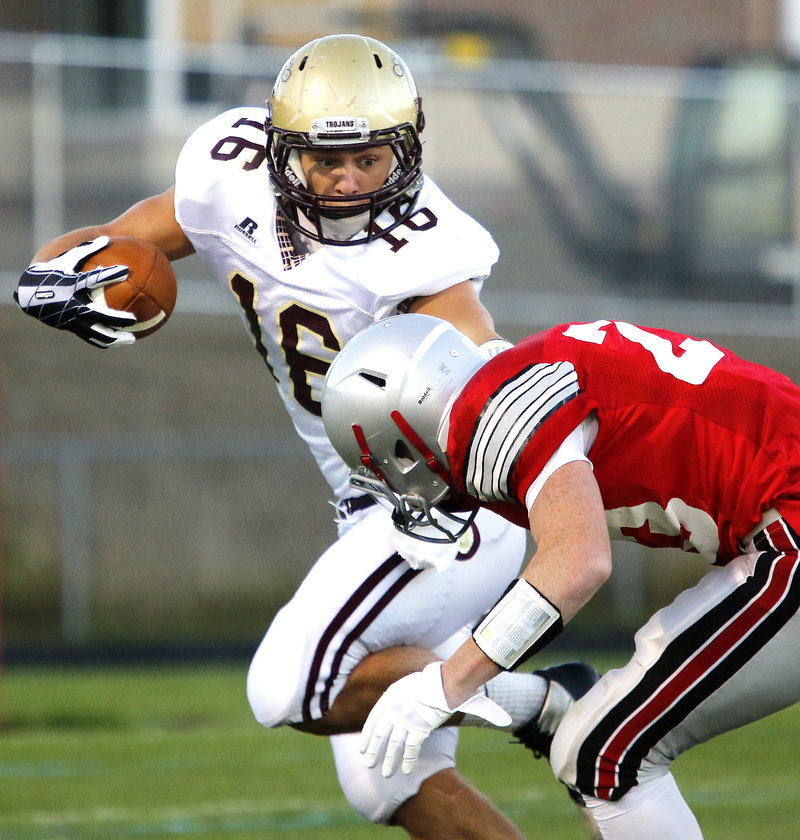 Andrew Libby of Thornton Academy, who was lost to a first-half injury on a kickoff return, looks for a way around Hayden Owen of South Portland.