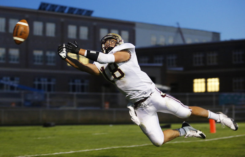 Cody Lynn of Thornton Academy dives for a pass that falls just out of reach Friday night during the Western Class A opener against South Portland. Thornton, the defending state champion, suffered a 26-13 setback.