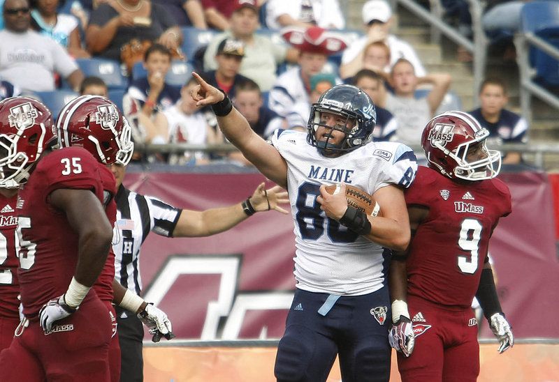 Maine tight end Justin Perillo celebrates a catch that set up a third-quarter touchdown Saturday at Gillette Stadium as the Black Bears knocked off Massachusetts, 24-14.