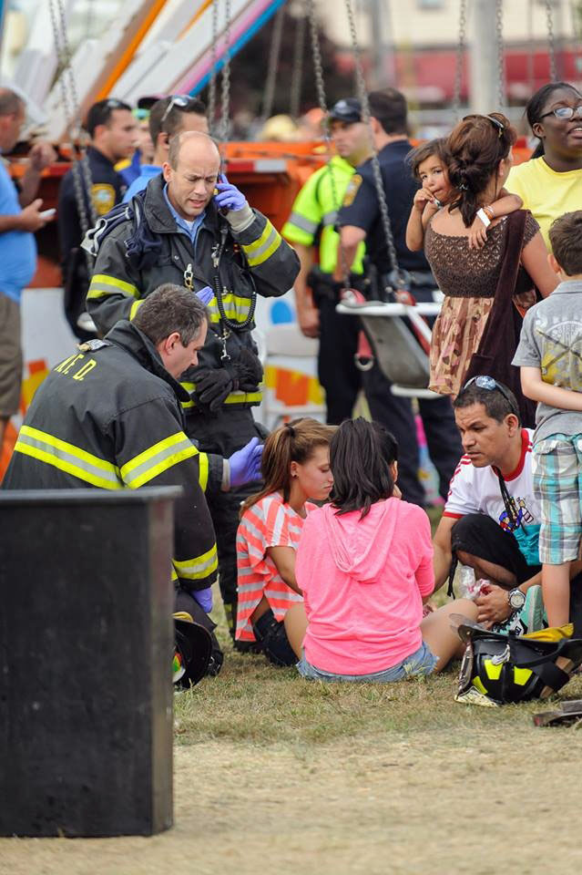 Twelve children were injured when a fair attraction that swings riders into the air lost power in Norwalk, Conn.