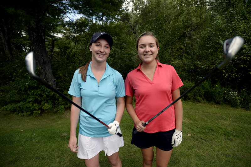Seniors Monica Austin, left, and Grace King are among Yarmouth High School's top golfers, and at ease playing with and against boys.