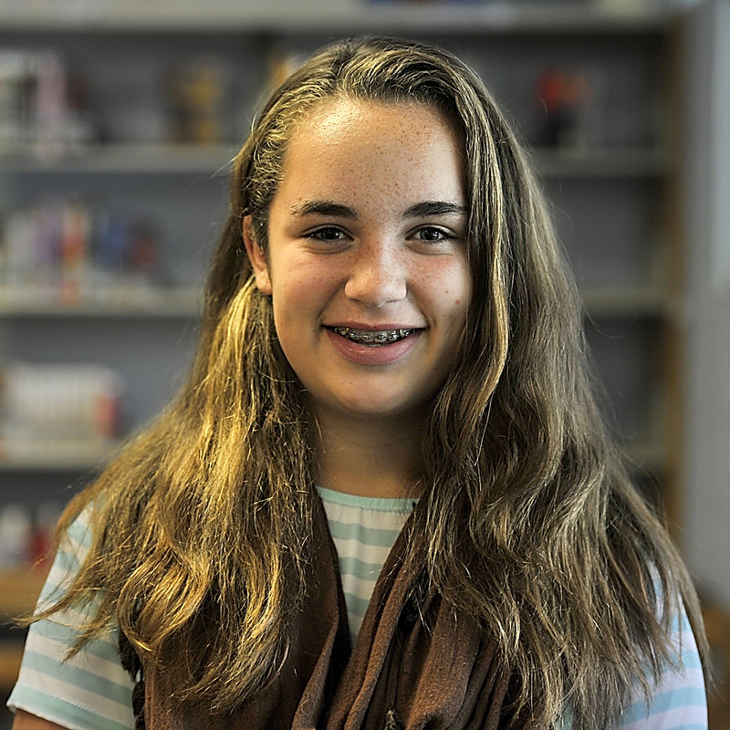 "Sophia Nolan, 12, a seventh-grade student of Karen MacDonald, tells why she likes her teacher. ""She really makes me a motivated student in school and in all the classes. ... She's just a really good teacher."""