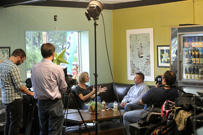 Shannon Moss interviews Police Chief Michael Sauschuck at Holy Donut in Portland for her self-produced local TV show.
