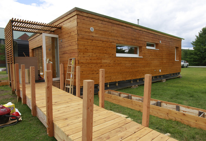 This July 30, 2013 photo shows the Norwich University solar-powered home sits in Northfield, Vt. Vermont's Norwich University and Middlebury College are sending their student-designed solar homes to the U.S. Department of Energy Solar Decathlon in California. Both schools built entries that blend affordability and consumer appeal with optimal energy production and maximum efficiency.(AP Photo/Toby Talbot)