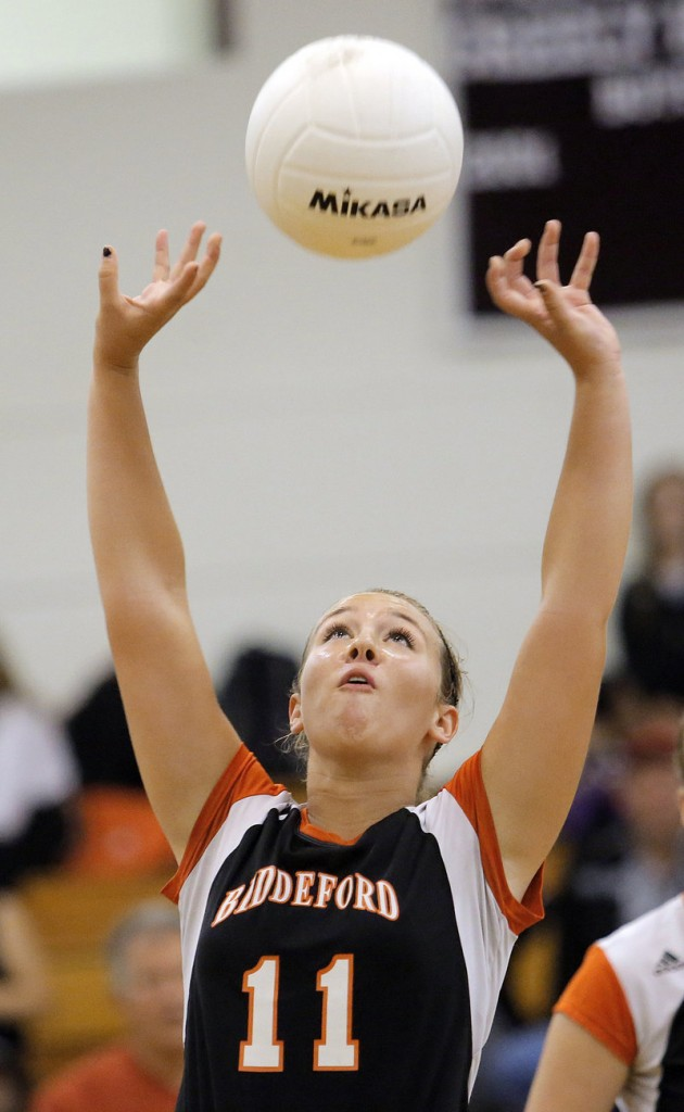 Kayla Fournier of Biddeford keeps her concentration while setting the ball during the match against Greely at Cumberland.