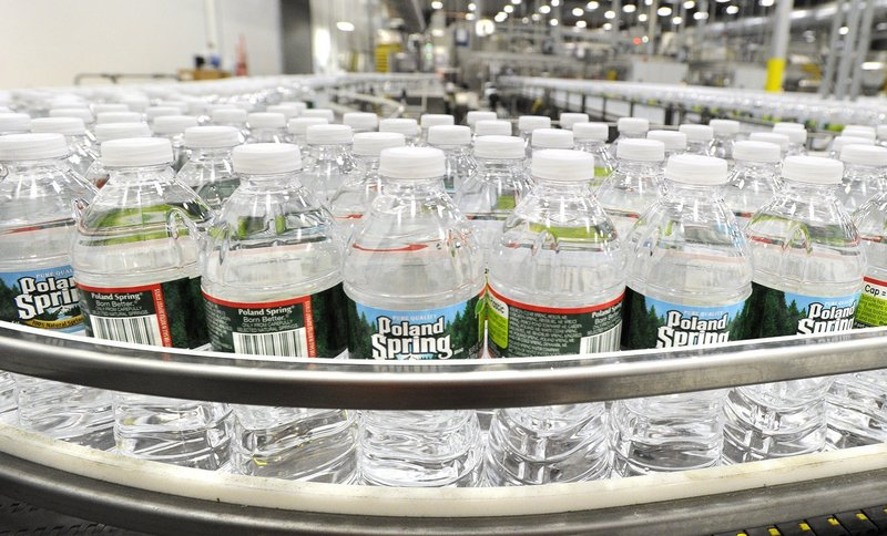 Bottles of water line the conveyor belt at Poland Spring's Hollis plant. Those who say the company is depleting southern Maine's water supply are misinformed, a reader says.