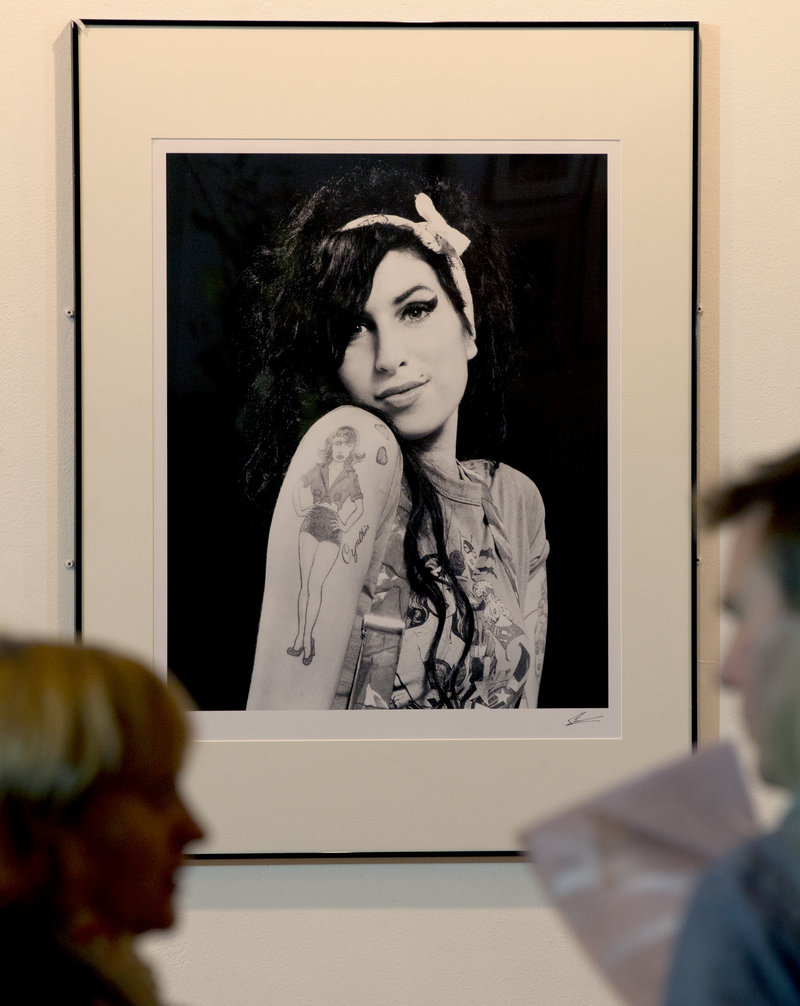 A portrait of British singer Amy Winehouse, who died in 2011 at age 27, hangs in the Proud gallery in Camden, London.
