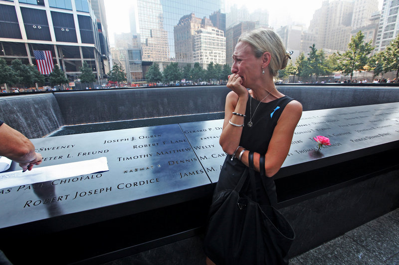 Carrie Bergonia views the name of her fiance, firefighter Joseph Ogren, during ceremonies Wednesday at the 9/11 Memorial marking the 12th anniversary of the attacks on the World Trade Center in New York.