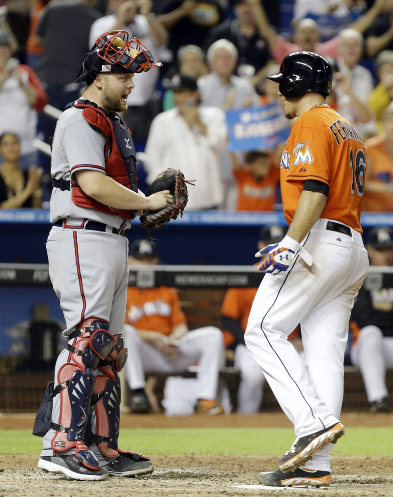 Atlanta catcher Brian McCann, left, and Miami pitcher Jose Fernandez exchange words after Fernandez hit a solo homer in Wednesday's victory in Miami.
