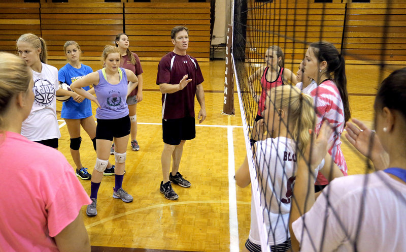 Thornton Academy Coach Keith O'Leary makes a point to his team during practice. Thornton had 90 prospects show up this fall; O'Leary is keeping about 75, spread between varsity, junior varsity and freshman teams.