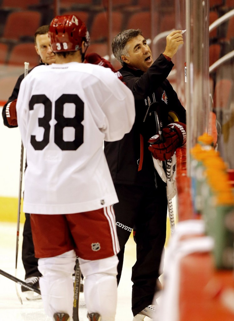 Phoenix Coach Dave Tippett diagrams a play during the Coyotes' first day of training camp in Glendale, Ariz. The Coyotes look to rebound after a disappointing season.