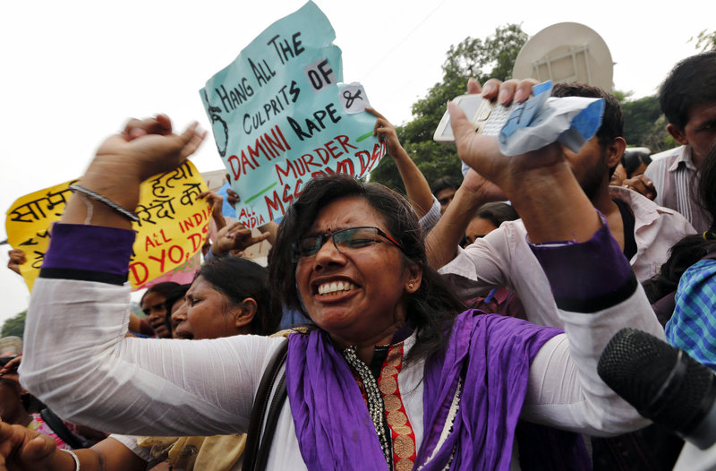A protester shouts Friday outside a court in New Delhi, India. All four men convicted of raping and murdering a 23-year-old woman in New Delhi were sentenced to death.
