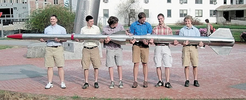 Team Ursa members hold the rocket they plan to send about 35 miles into the atmosphere. They are, from left: Josh Mueller of Cannon Falls, Ryan Means of York, Luke Saindon of Deer Isle, Alex Morrow of Washburn, Robert Miller of Portland and Gerard Desjardins of Mapleton. Winslow resident Michael Ostromecky is not pictured.
