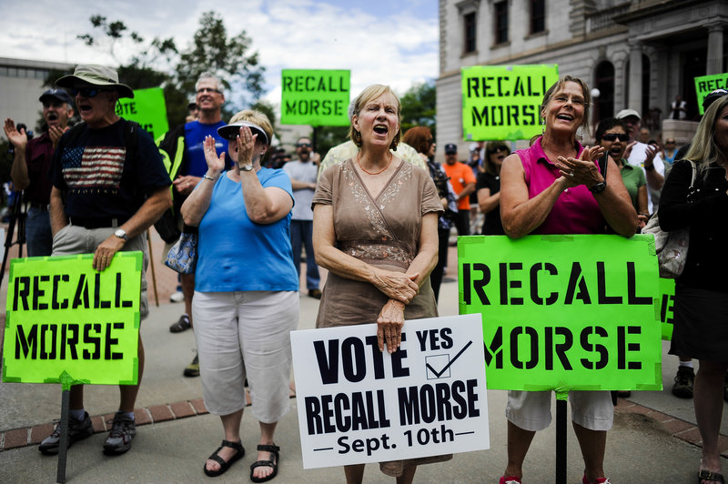 Supporters of the recall election to oust Colorado Senate President John Morse rally outside the Pioneer Museum in Colorado Springs, Colo., on Sept. 4.