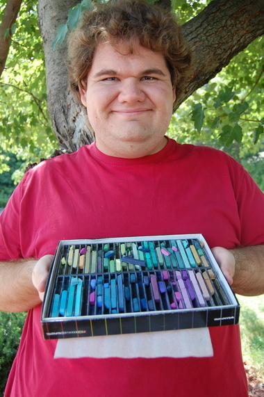 Dallas Looman, 25, displays the pastels that he enjoys using.
