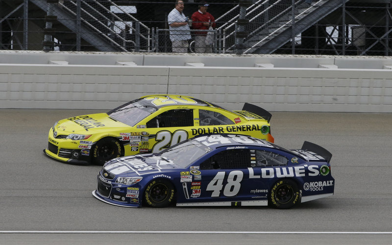 Matt Kenseth (20) drives past Jimmie Johnson during the NASCAR Sprint Cup auto race Sunday en route to victory at Chicagoland Speedway. Johnson finished fifth.