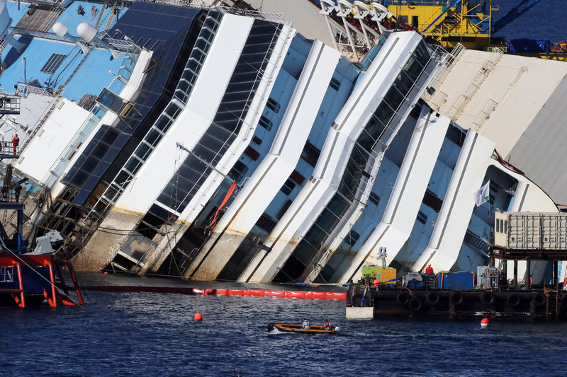 The Costa Concordia lies on its side near Giglio, Italy, as engineers work to raise it off a reef .