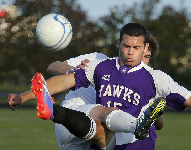 Noah McDaniel, front, of Marshwood and Colin Grove of Cheverus get tangled up as they battle for the ball during an SMAA soccer match Monday in Portland. Grove led the Stags to a 5-1 triumph.