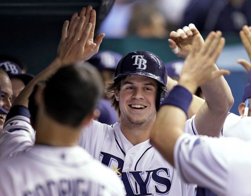 Tampa Bay's Wil Myers is glad-handed after his second-inning homer during a 6-2 Rays win at St. Petersburg, Fla., on Monday.